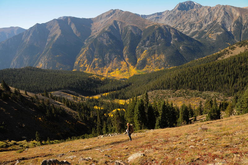 A lone hiker enjoys the solitude and fall colors on the south approach to Mount Elbert.