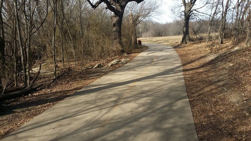 This is a typical section of paved trail in Arbor Hills Nature Preserve.