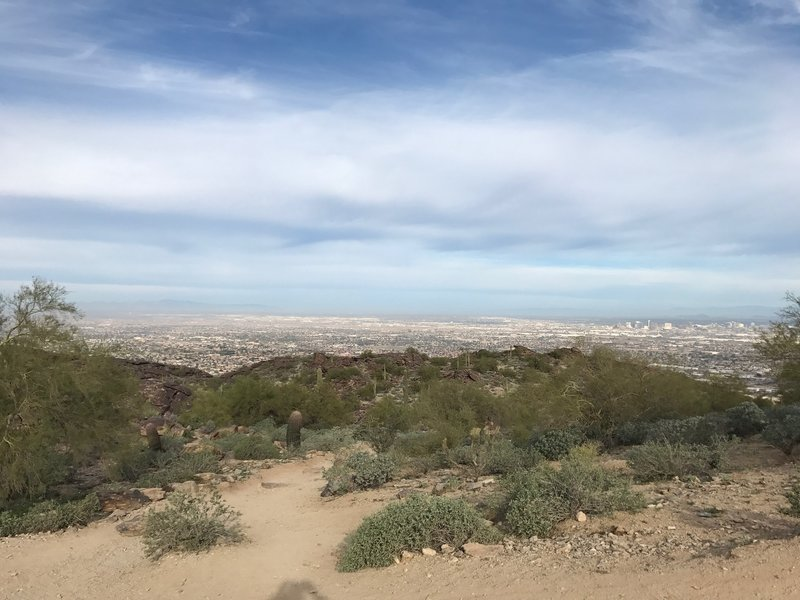 Enjoy this pleasant view of South Mountain Park and the Phoenix Metro from the top of Mormon Trail.