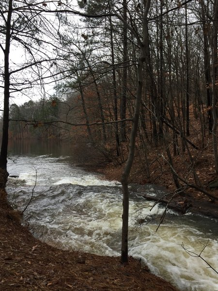 Water flows heavily from the creek into Stone Mountain Lake after a couple days of rain.