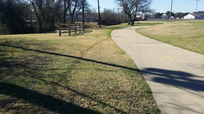 The trail is smooth as it passes by Mark Twain Elementary.