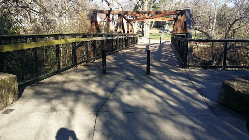 This sturdy footbridge connects the trail to the parking lot.