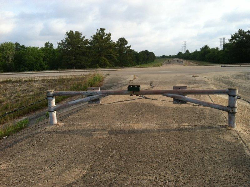 Addicks Dam Road: Crossing at Clay Road, looking north.
