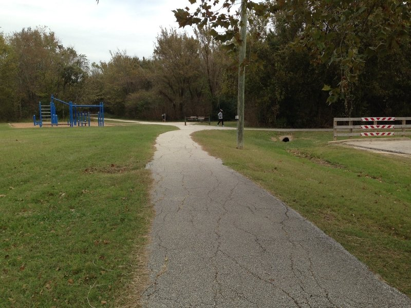 This is the west end of Cullen Park Bike and Hike Trail looking east at the trail leaving the parking lot.