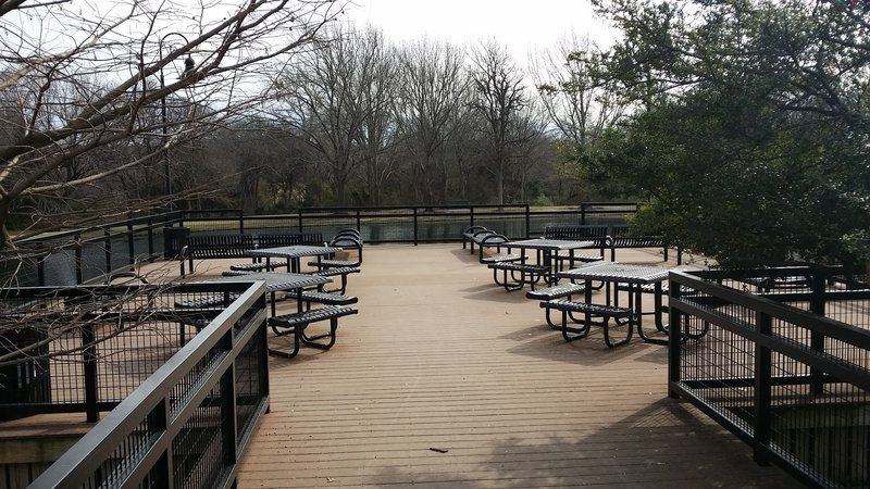 Enjoy the pond and surrounding nature from this great picnic spot along the trail.