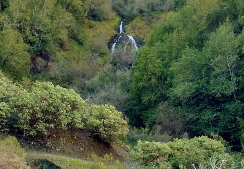 A waterfall splits as it tumbles down a rock face along the Limekiln Trail on its way to Lexington Reservoir.