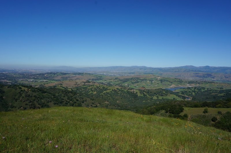 Enjoy expansive views of the valley from the top of the hill near the picnic bench.