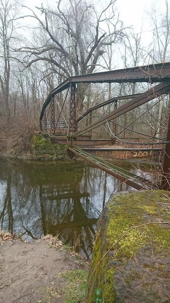 The remains of a former bridge over the Scantic River still stand near the trailhead.