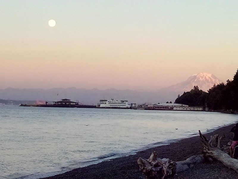 Mt. Rainier and the moon hide behind the Vashon Island Ferry and Tacoma Yacht Club.