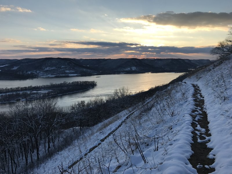 A winter sun sets over the goat prairie switchback on the Brady's Bluff Trail.