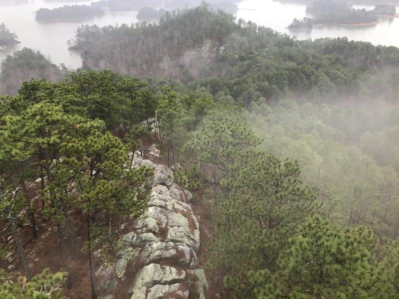 A fog rolls over the ridge below the fire tower.