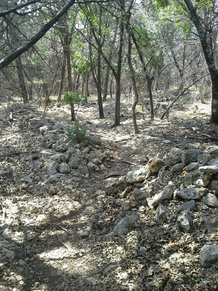 The Goldwater Loop Trail makes a pass through an old rock wall.