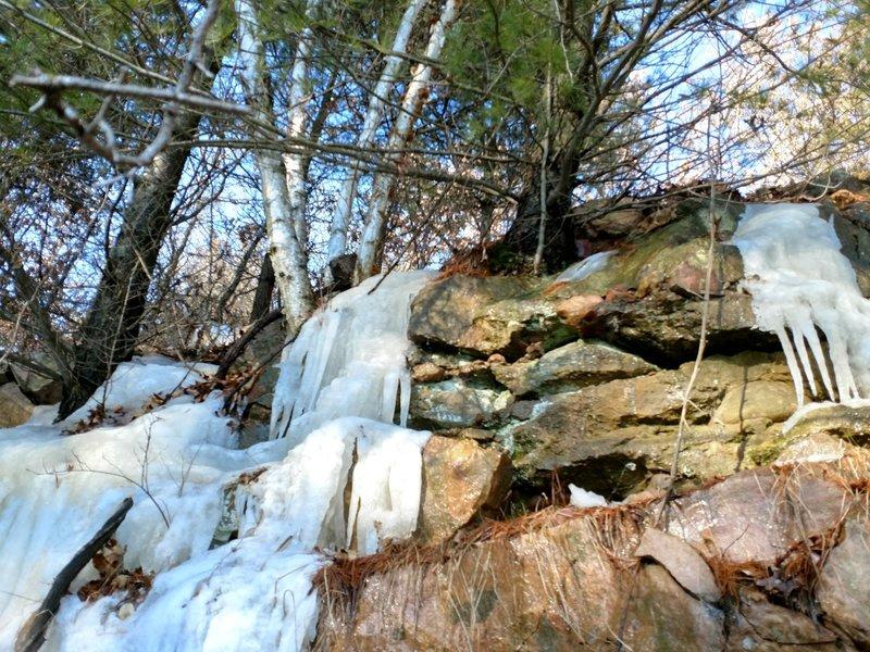 Frozen water streams down the rocks near Badger Overlook.