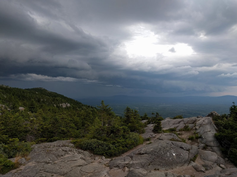 Storm clouds rolling in from the north at Three Quarters Ledge on the White Dot Trail.