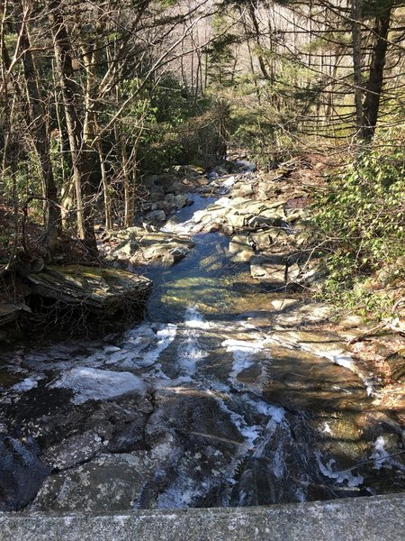 A waterfall slackens into a stream along the Flat Laurel Creek Trail.