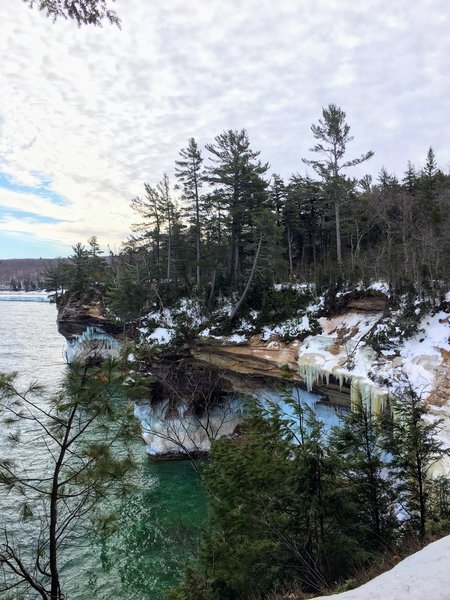 Icy cliffs surround the lakeshore in February.