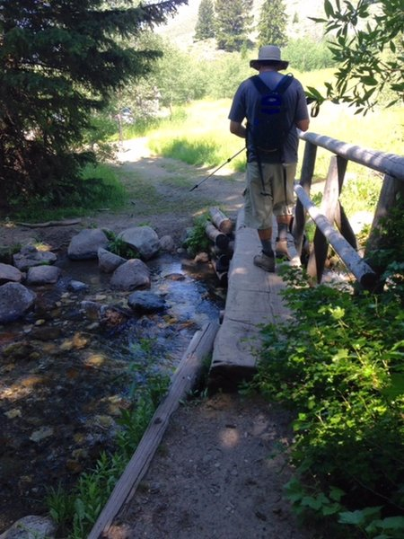 A narrow footbridge aids your passage over Corral Creek near the trailhead.