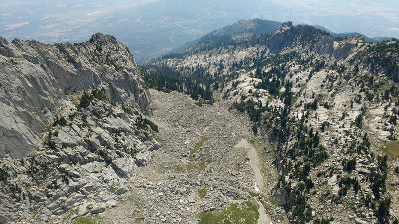 Alpine glaciers have carved a steep cirque from the western side of Lone Peak.
