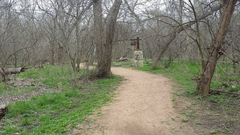 The well-maintained gravel/dirt surface of the Pecan Grove Trail provides an enjoyable soft surface for your feet.
