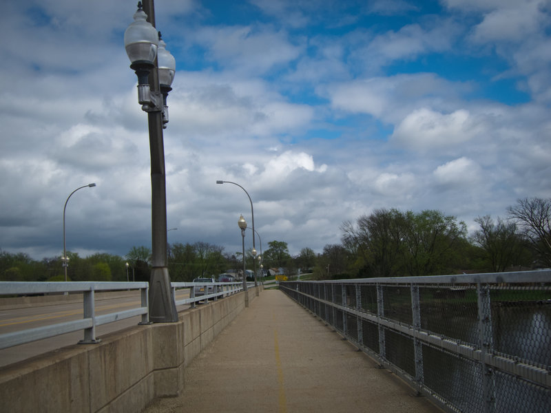 The Rock River Recreation Path is separated from traffic by a concrete barrier on the Harlem Road Bridge.