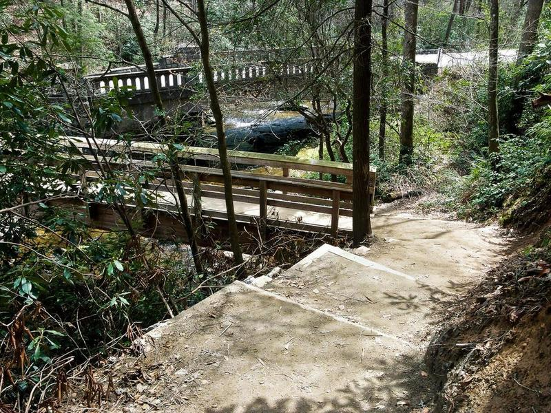 Start the trail by crossing a sturdy wooden bridge over the gurgling Looking Glass Creek.
