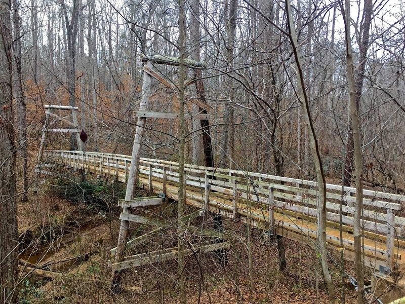 A monstrous suspension bridge aids your passage over Walnut Creek.