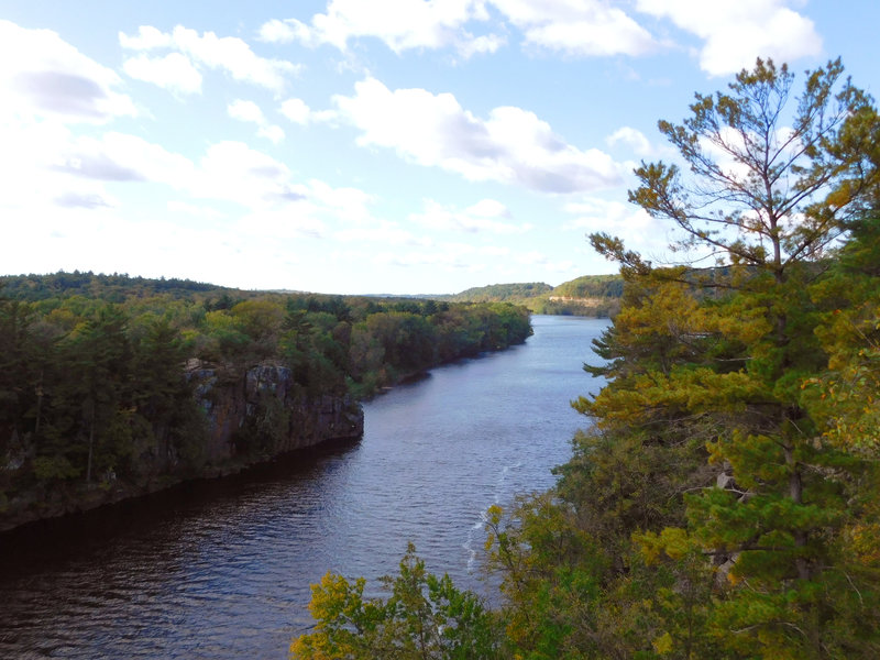 The mighty St. Croix River flows through the towering cliffs lining its banks.