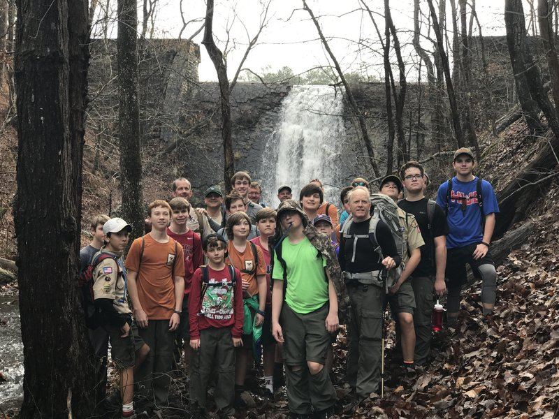 A scout group poses for a photo at the spillway.