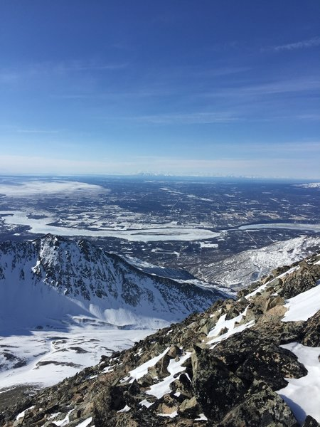 In March, enjoy expansive, snow-covered views from just below the summit on Matanuska Peak.