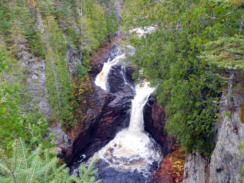 The mysterious Devil's Kettle drops through forest and bedrock to the water below.