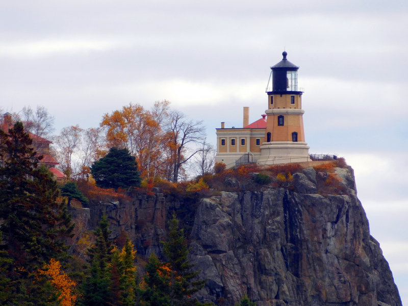 Split Rock Lighthouse stands perched atop the cliff.
