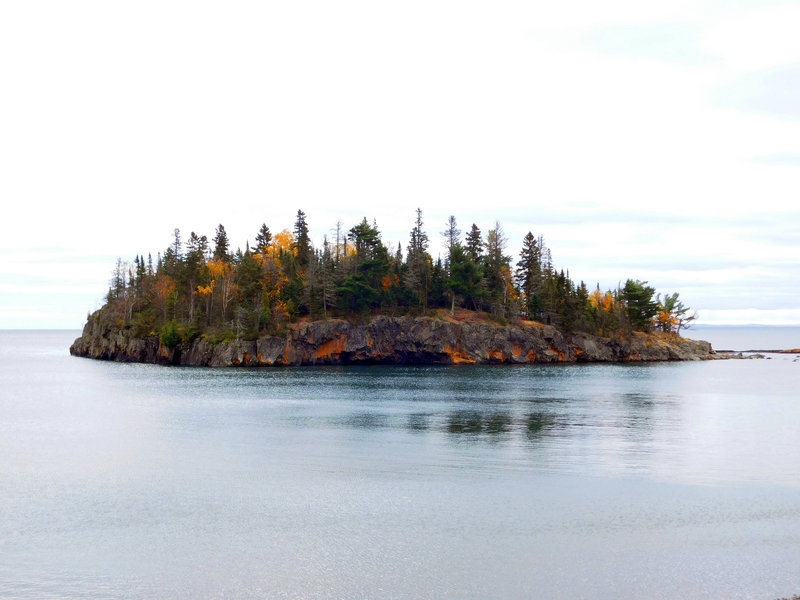 Ellingson Island holds its fall color as it floats just offshore.