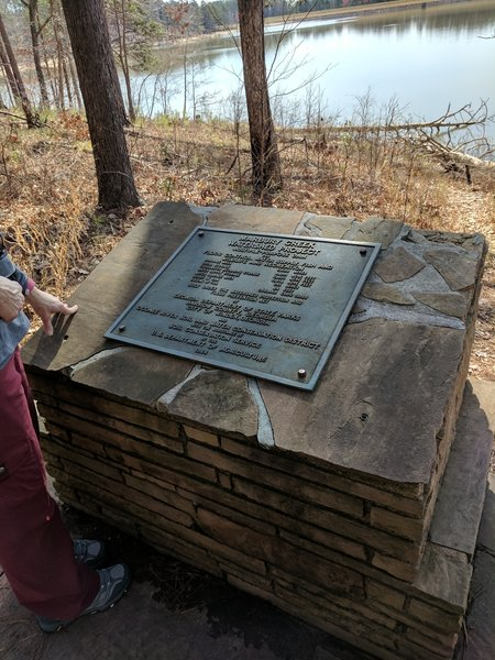 Along the trail, a monument and placard stand to commemorate the Marbury Creek Watershed Project.