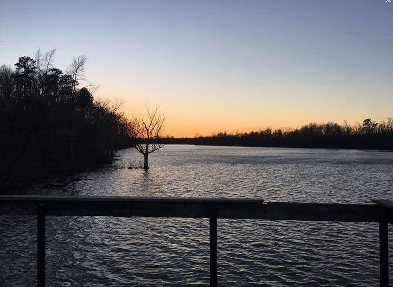 The sun sets over the Appomattox River.