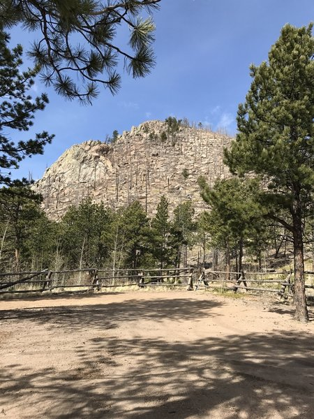 The trail starts just past the fence and heads to the top of Signal Butte.