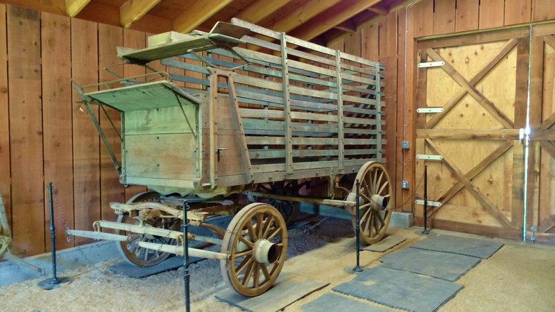 Some sort of old ranch wagon (no descriptive plaque yet...) awaits inside one of the old structures.