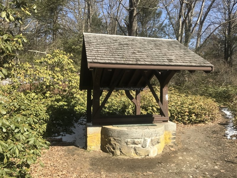 A wishing well is located just off the trail.