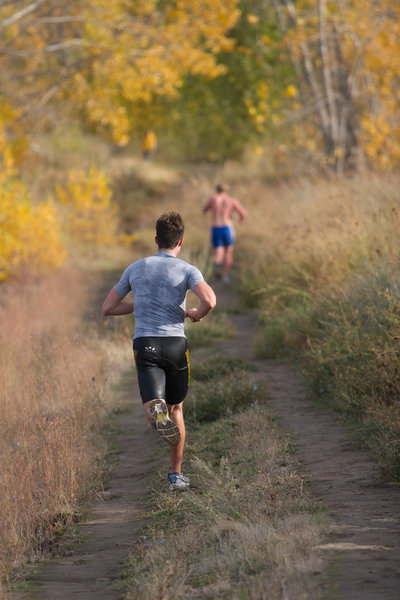 Runners from Western Washington University compete in a triathlon along the Meadowlark Trail in Bennington Lake, WA.