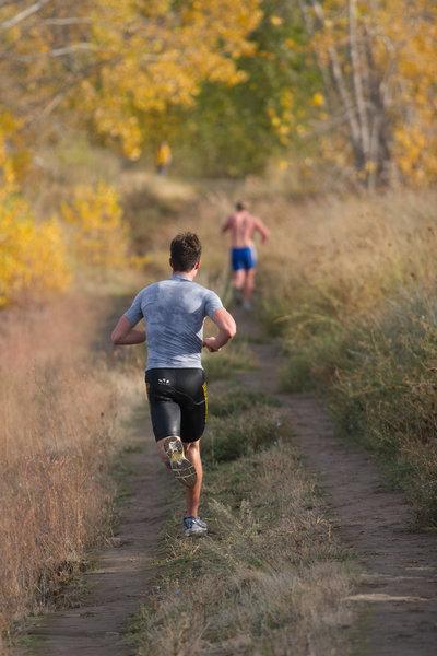 Runners from Western Washington University compete in a triathlon along the Meadowlark Trail in Bennington Lake, WA.