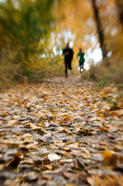 A pair enjoys a fall run at Bennington Lake.