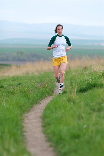 A runner finishes up a lap on the Whitetail Trail at Bennington Lake.