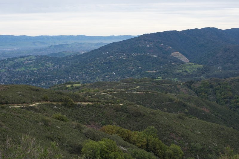 The Aquinas Trail can be seen snaking along the ridge below you in El Sereno Open Space.