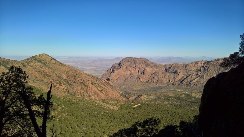 From the Pinnacles Trail, enjoy this view of The Window and Chisos Basin before cresting the trail near Emory Peak and the Boot Canyon Trail.