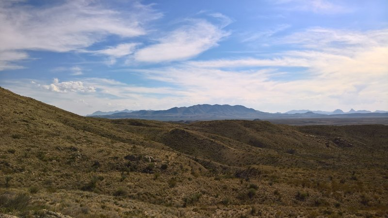 The Rosillos Mountains command the center of the image, while the Chisos Mountains are behind them in the distance.