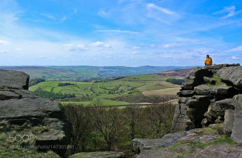 A hiker enjoys the view along the Strange Edge.