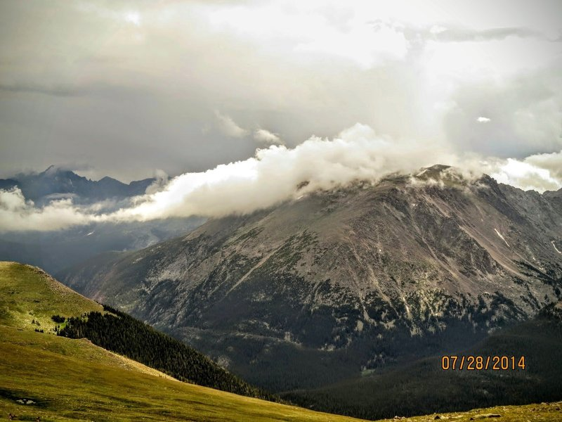 Clouds roll over the mountains across Trail Ridge Road.