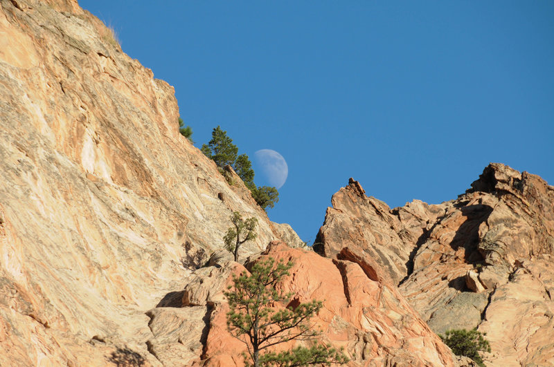 The moon hides behind Gray Rock.