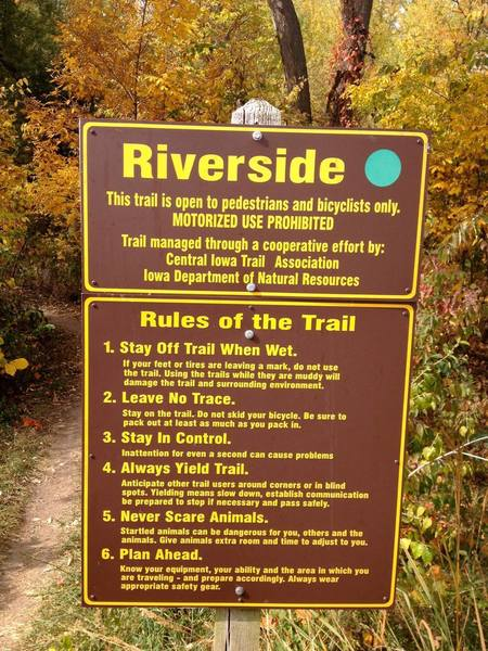 A sign marks the beginning of Riverside.