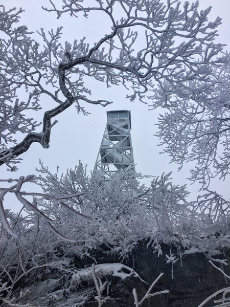 The fire tower was covered in plenty of ice amidst the throes of winter.