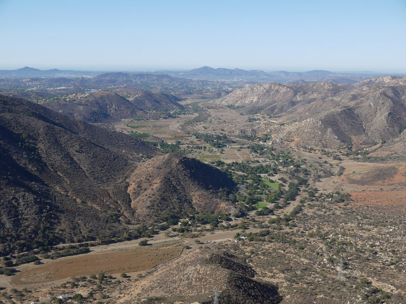 Enjoy the view looking back at El Monte County Park from the prow of El Cajon Mountain.